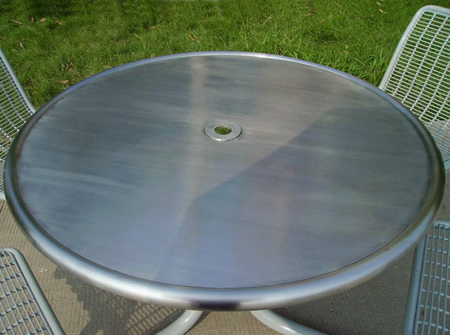 Solid Fiberglass Tabletop With Round Border Design And Optional Umbrella  Hole.